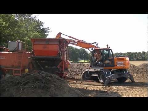 Doosan DX140W Loading Potatoes.