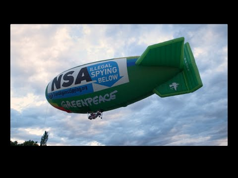 Illegal Spying Below: Activists Fly Anti-Surveillance Airship over NSA's Utah Data Center