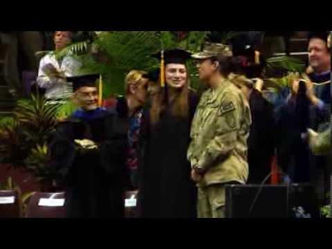 Navy lieutenant surprises sister at Florida State graduation