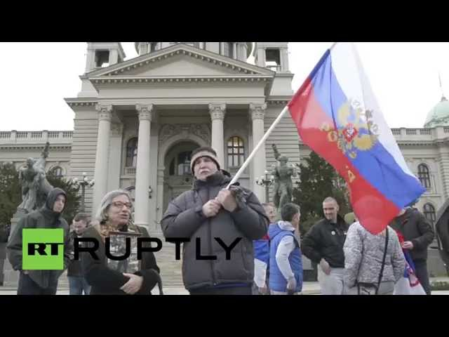 Serbia: Watch anti-NATO protesters booing seminar participants