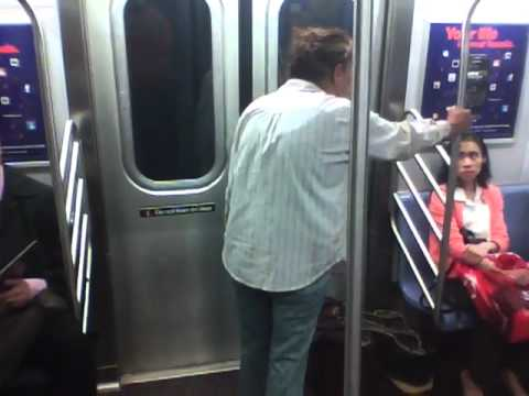 crazy lady attacks! nyc subway