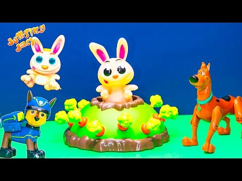 Playing the Jumping Jack Game with Paw Patrol vs  Scooby Doo Toys