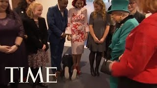 Young Boy Overwhelmed By Meeting UK Queen Crawls Away | TIME