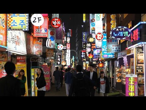Seoul Neon Street Electronic By Night, Asian Shopping, Shoppers In South Korea. Stock Footage