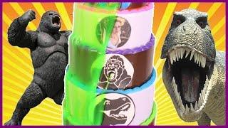 Dinosaurs vs King Kong SLIME CAKE GAME with Jurassic World Dinosaur Toys + Slime Kids Games