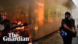 Hong Kong protesters gather in shopping district and vandalise rail station