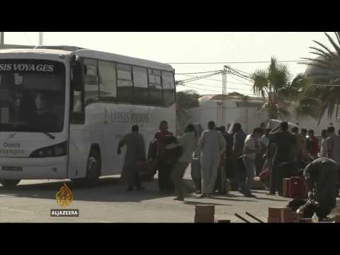 Tunisia seals Libya border after violence