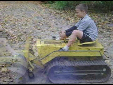 johnny and his sister driving the mini dozer he got for his birthday.