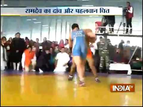 Baba Ramdev exhibits his wrestling skills On ashram's foundation day
