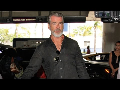 Pierce Brosnan Looking Exhausted At LAX After Late-Night Partying With Sting