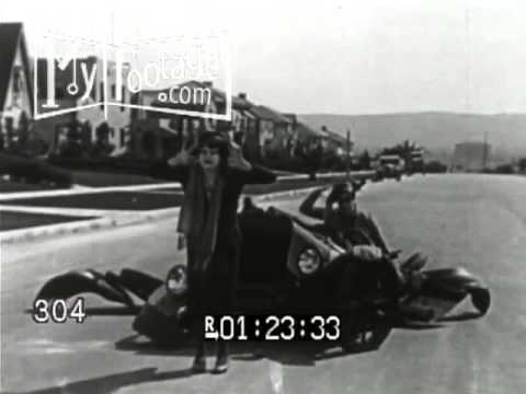 Stock Footage - WOMAN RUNS IN FRONT OF CAR. CAR COLLAPSES. GOOFY GAGS, SILENT FILM 1920s