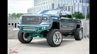 Teal blue 2014 GMC sierra using Bodyguard bumpers along with 24x14s and a 10 inch lift!