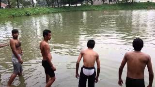 Swimming in Bangladeshi Pond