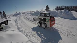 moving snow with the bobcatg