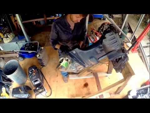 Removing the power trim tilt unit from an outboard motor