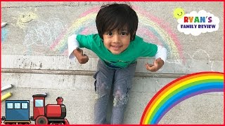 Kid Playtime outside with a Colorful Chalk drawing rainbow and truck with Ryan