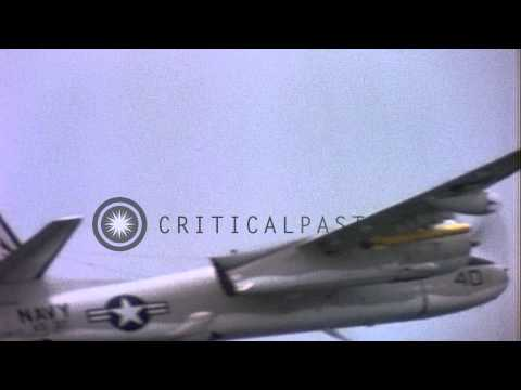 USN S-2As Tracker aircraft fly in formation with Sikorsky SH-3As helicopter from ...HD Stock Footage