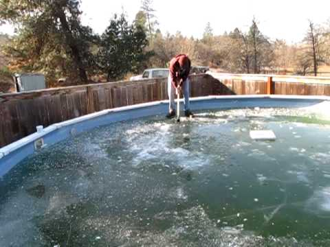 My friend decides its a good idea to try to break the ice in his pool then chops circle aroung him and falls in...