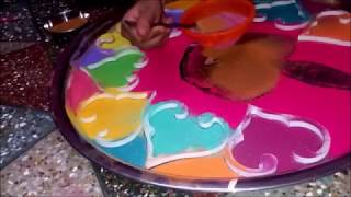 Colorful rangoli design by little girls