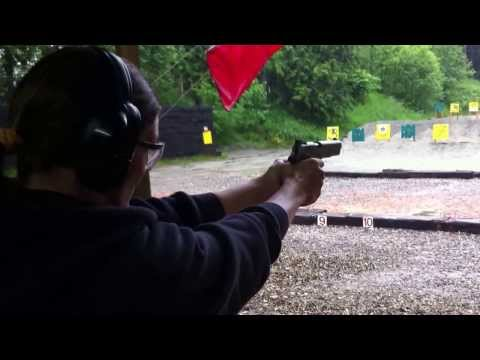Girl Shooting Sig Model 1911 Semi Auto Pistol .22 Caliber At The Local Outdoor G