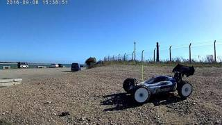 Rc team associated rc8.2e buggy fast jumps and wheelie.