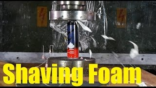 Crushing spray cans with hydraulic press