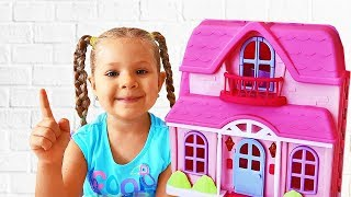 Diana and Roma pretend play with toy house