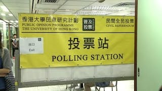 Hong Kongers defy Beijing to vote in democracy referendum