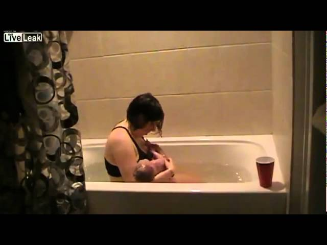 Woman Giving Birth in a Bathtub
