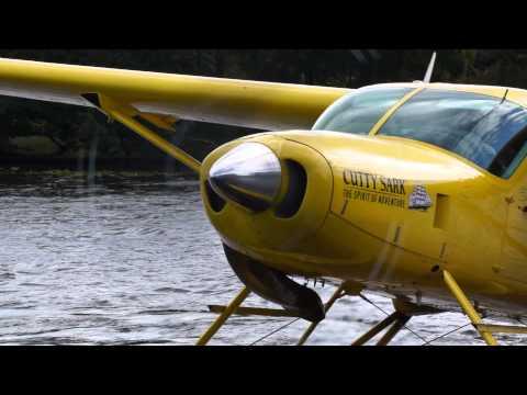 Seaplane landing, taxi and takeoff, Loch Lomond (Lake), Scotland