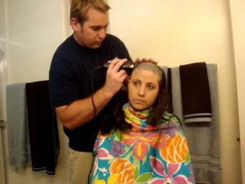 29-year-old woman with breast cancer shaves her head.