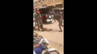 Nigerian Soldiers beat up crippled man for wearing camouflage in Anambra (Video)