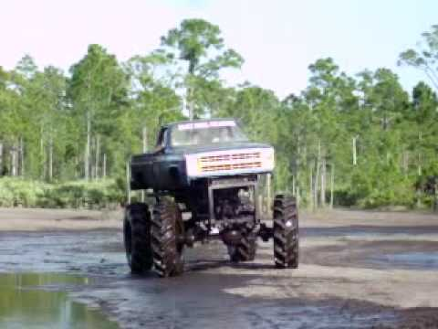 BAD ASS BIG TRUCKS IN THE MUD. MUDDING. ((( PART 1 OF 2 ))) Video