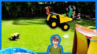 Monster Trucks and Dump Trucks for Kids Ramp Into Orbeez Pool!