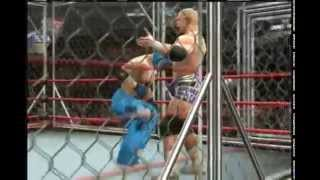 Rey Mysterio vs Hardcore Holly in a cage match