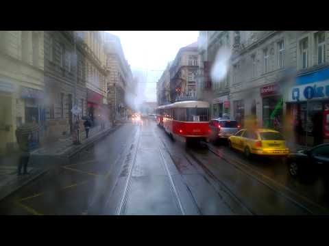 Prague in rain from tram perspective