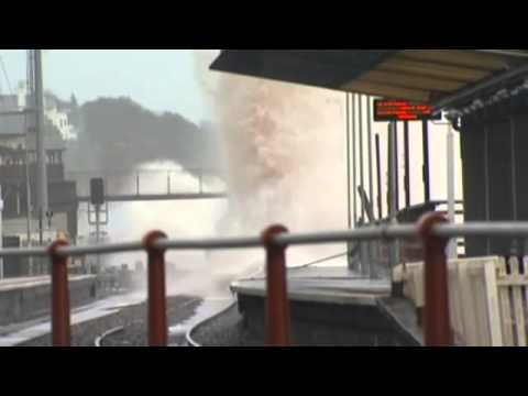 UK storms: Dawlish seawall collapses and rail tracks battered by extreme weather    World news