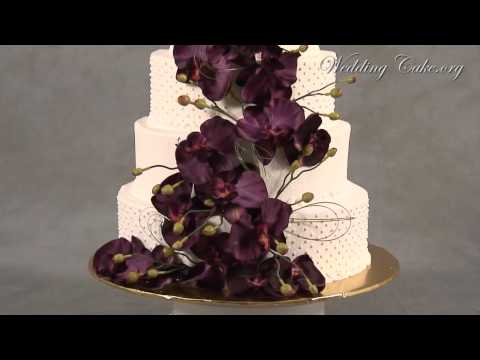 5 Tier lace detail wedding cake with purple fuschia and pink orchids