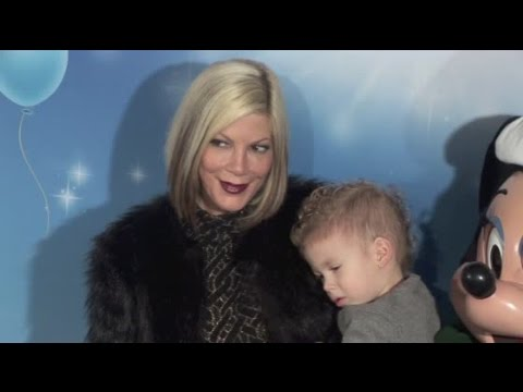 TORI SPELLING and DEAN McDERMOTT bring their four kids to Disney on Ice