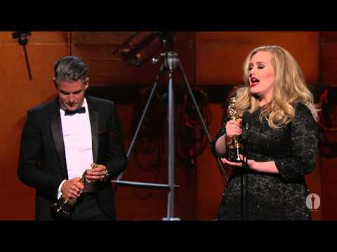 """Chicago"" stars--Richard Gere, Renée Zellweger, Queen Latifah and Catherine Zeta-Jones--presenting Adele Adkins and Paul Epworth the Oscar® for Best Original..."