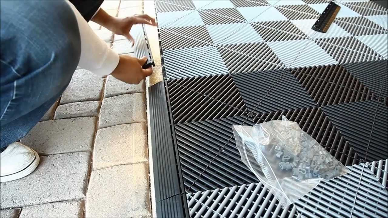 Rubberised floor tiles