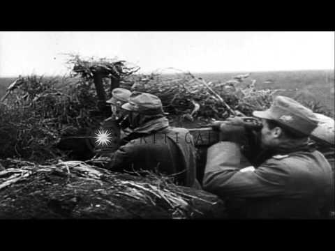 German forces,attempting to hold the line, fire artillery at at advancing Soviets...HD Stock Footage