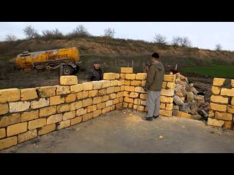 Кладка камня стены из ракушки