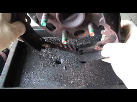 Replacing Drum Brake Shoes Part 1 - EricTheCarGuy