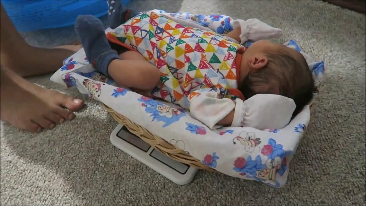 Как взвесит ребенка в домашних условиях 594