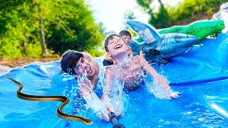EPiC BACKYARD WATERSLIDE with SNAKES!?! 💦