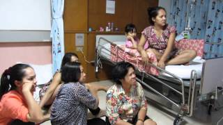 Thai family watching a Lakorn soap opera in a hospital roomThailand 2013