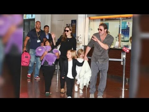 Brad Pitt and Angelina Jolie and Kids Look Happy in Japan - Splash News