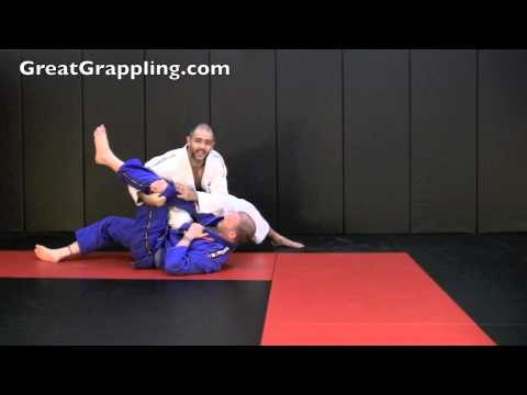 X Guard Sweep Roll to Knee on Belly Image 1