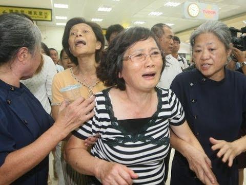 Raw: Families Travel to Taiwan Plane Crash Site